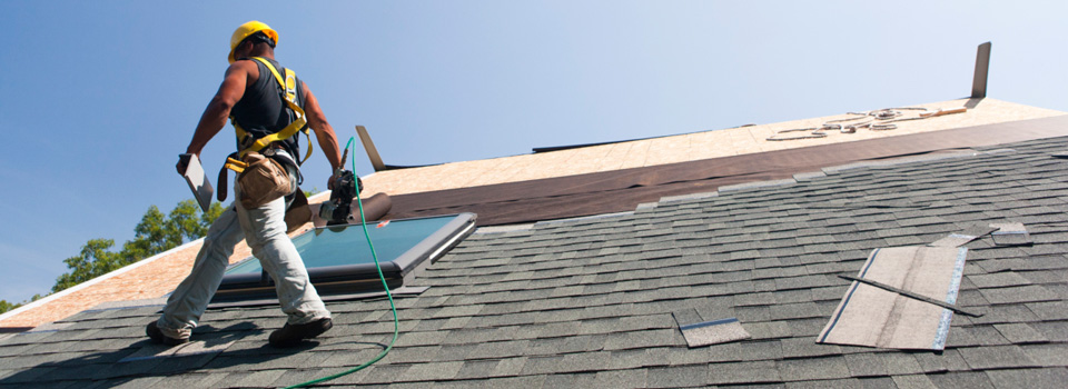 Roofer installing shingles
